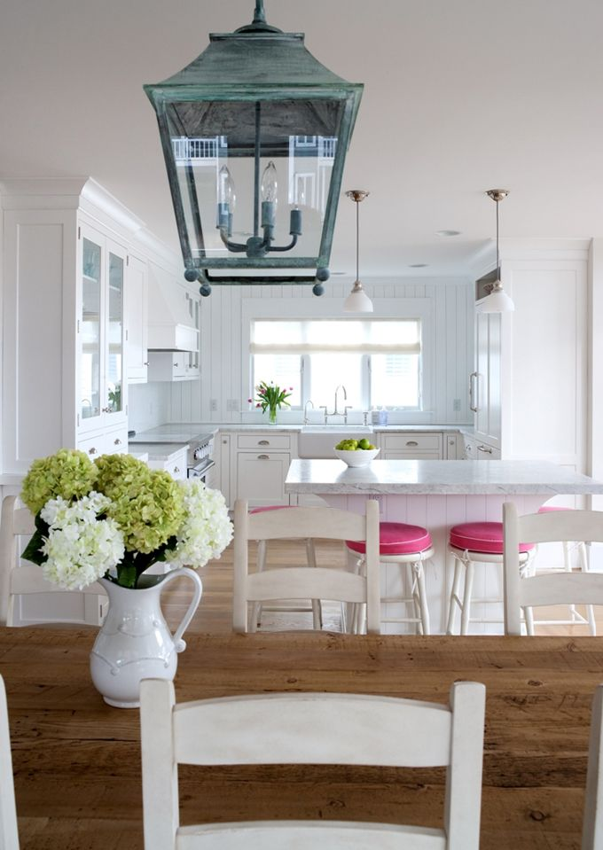 beach house: white kitchen with Antico Namibian White granite {which is less porous and shows fewer stains than marble} and plank walls/island: Love the lantern light fixture!