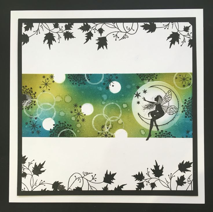 This card was created by Tracy Nutton using distress inks and Lavinia stamps - vine, dandelions, miniature stars and moon fairy.