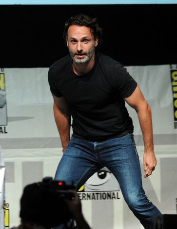 Andrew Lincoln - hehe had to point out the eye of the Comic Con logo is staring right at his crotch XD