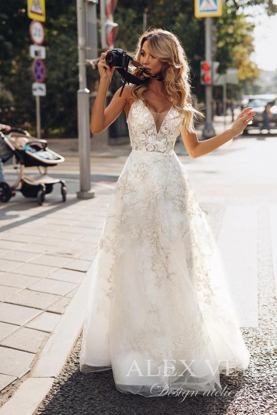 Wedding Dress Goldie Amazing A Line Lace Wedding Dress With A Plunging Neckline And Original Back Design Vesilna Kolekciya Vesilni Sukni Sukni