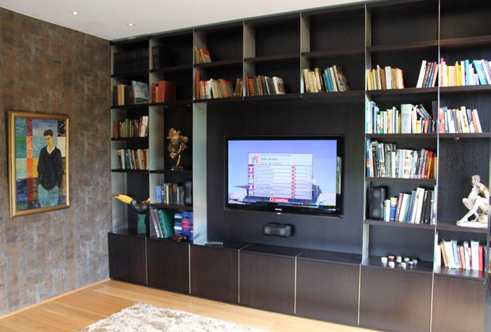 Plazma screen and speakers intergrated into bespoke library surround. All designed and manufactured by 3rdEdition. Within this private build, we built the Kitchen, Stairs, Study, Library, Master bathroom furniture and His/Hers Walk-in wardrobes. Email info@3rdedition.co.uk or call 01793 529496 for more details.