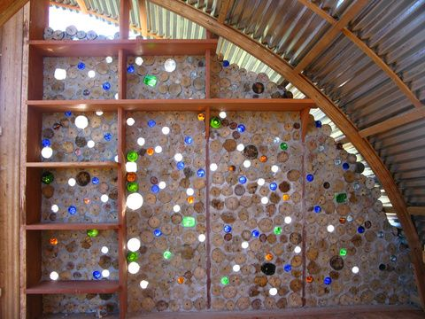 Built into a concrete wall, recycled beer and liquor bottles let colored light filter into the cabana; passing breezes create sound effects on the mouths of the bottles.  Eco-Cabanas in Venezuela, by Kristofer Nonn.