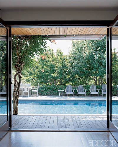 Hamptons Haven    Cedar decking and Adirondack chairs give the pool at the Bridgehampton, New York, home of artist Chuck Close and his wife, landscape historian Leslie Rose Close, a laid-back chic look.