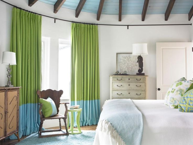 this gorgeous coastal bedroom features fun bright curtains hung on an extended rod that fits curtain ideascurtain