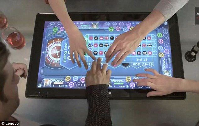 Lenovo has unveiled a computer the size of a coffee table that works like a giant tablet and can be used by up to four people at once