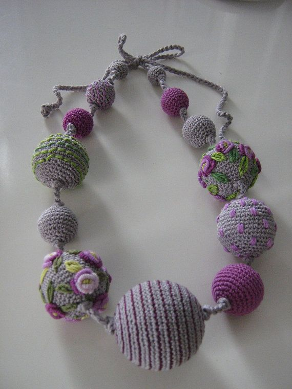 Necklace is made from crochet, polyester balls - 100% cotton It is very light and comfortable to wear.  Diameter of balls: 1 -3,5 cm  Materials: 100% cotton  Lenght: 115 cm