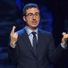 """FILE - In this Feb. 28, 2015 file photo, John Oliver speaks at Comedy Central's """"Night of Too Many Stars: America Comes Together for Autism Programs"""" in New York. Oliver used nearly the entire season finale of his HBO show on Nov. 13, 2016, to criticize President-elect Donald Trump. (Photo by Charles Sykes/Invision/AP, File)"""