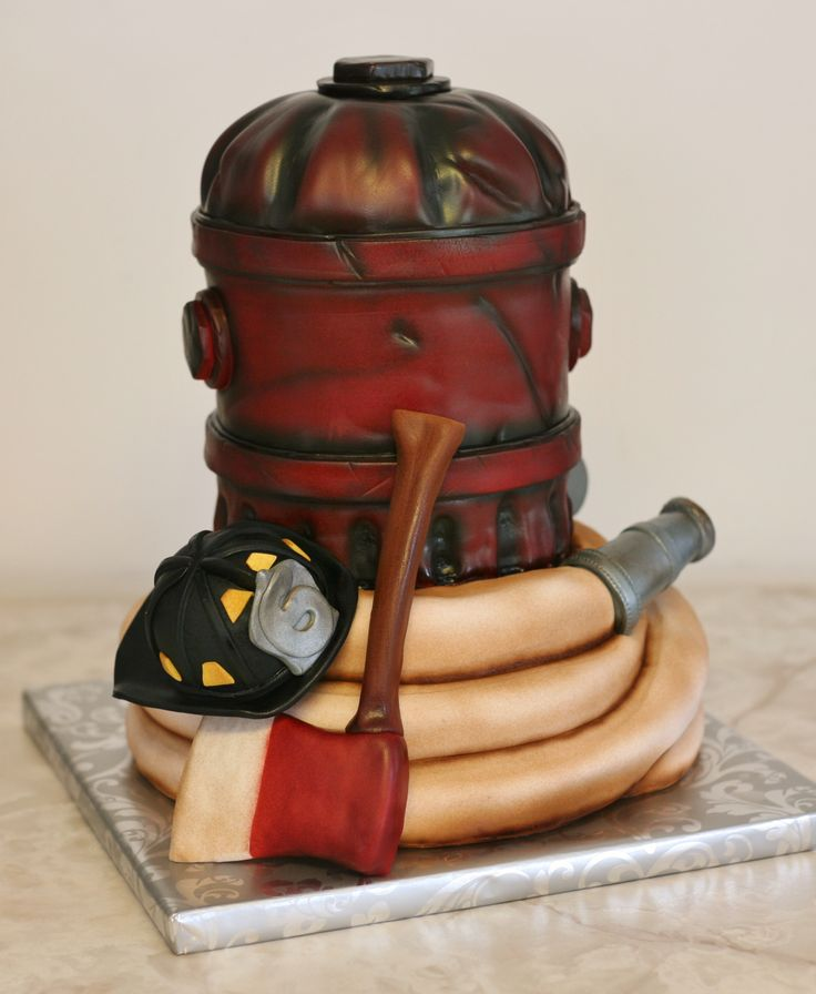 Firefighter's groom's cake - The helmet, axe and hose nozzle are RKT. Everything else is cake.