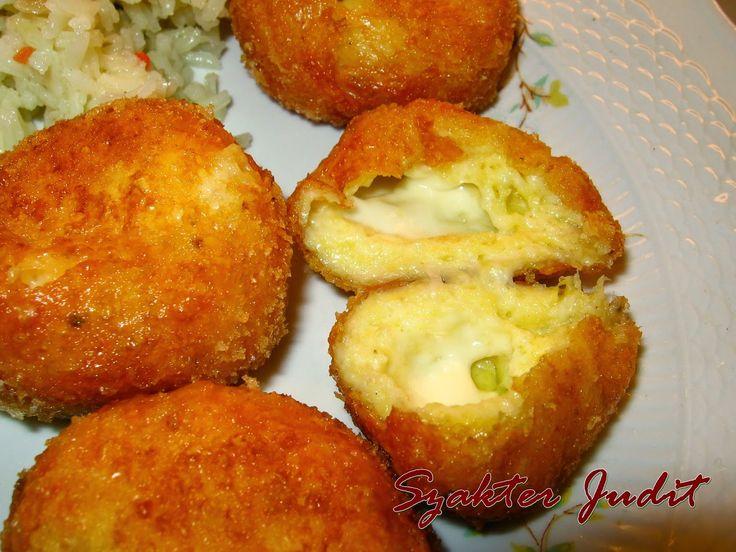 Sajttal töltött sajtgolyó       Hozzávalók:   35 dkg trappista  1 tojás  1,5 kanál liszt  csipet só  csipet őrölt szerecsendió  csipet őrölt...
