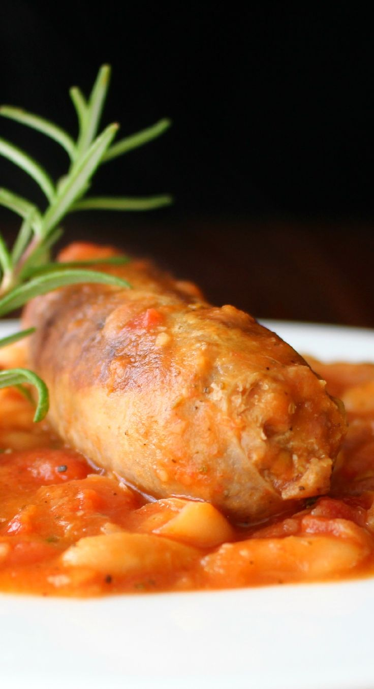 """Italian """"Ucceletto"""" Style Cannellini Beans and Sausage is a delicious combination of savory herbs and rich tomato sauce. Better than a restaurant dish!"""