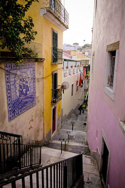 Alfama... I hear the echoes in your streets... the haunted shadows of lives left unsatisfied... mourning in the longing for love taken... taken by the sea... xo