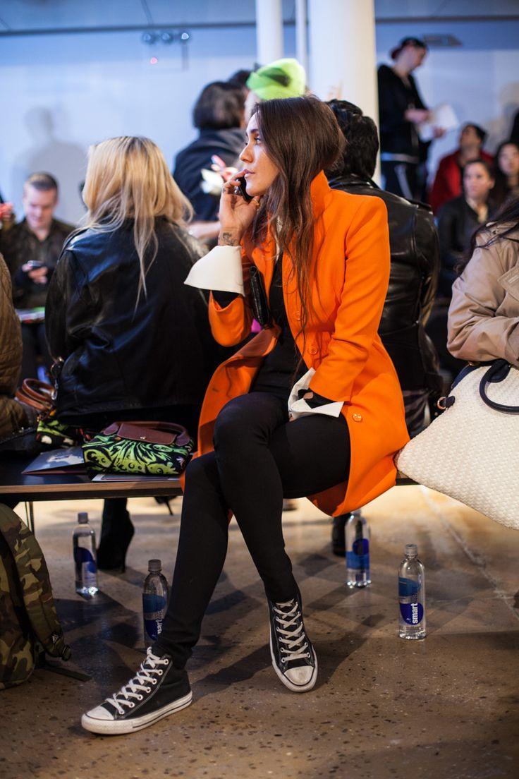 orange coat and converse