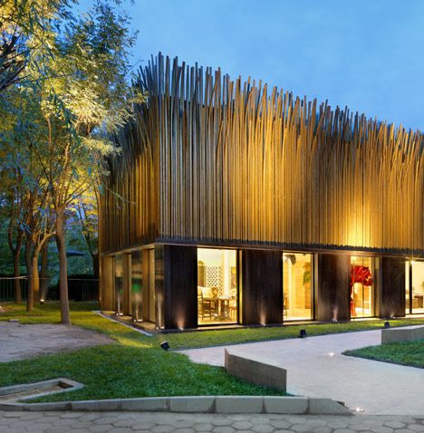 Italian designer Luca Nichetto created a pavilion in Beijing with a facade covered in 1200 vertical brass tubes