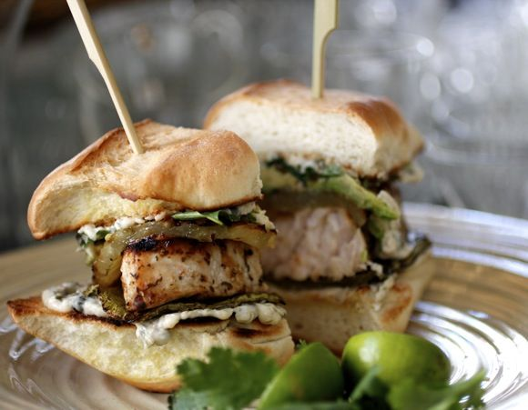 Baja Fish Torta ~ Grilled Fresh Swordfish with Grilled Nopalitos (cactus), Pineapple, Avocado, Caper Cumin Aioli, Pickled Jalapeño, Cilantro.  On a Bolillo (Crusty Mexican Oval-Shaped Roll).