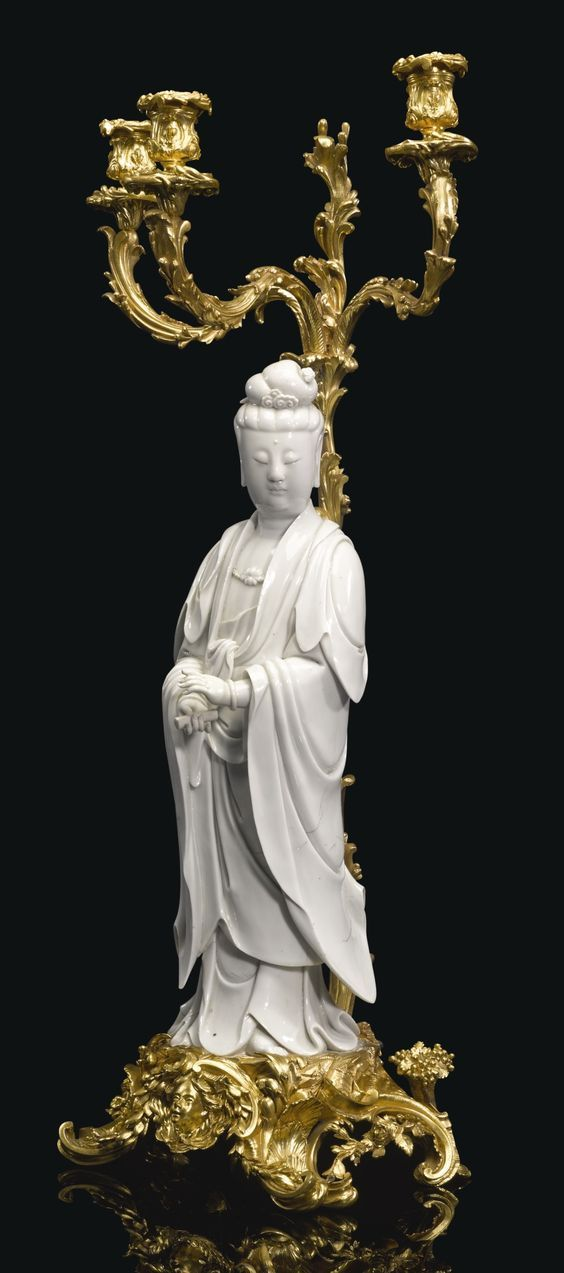 PROPERTY FROM A SWISS PRIVATE COLLECTION  A French gilt-bronze three-light candelabra with a Chinese porcelain blanc-de-chine figure of a Guanyin the porcelain Qing dynasty, 19th century, the mounts late 19th century
