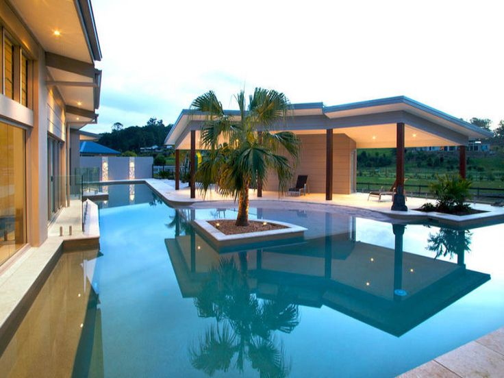 In-ground pool design using tiles with decking & ground lighting - Pool photo 151568