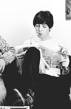 """ Paul McCartney, smoking and looking at a Swedish newspaper at Foresta Hotel in Stockholm, Sweden - July 28 1964 """