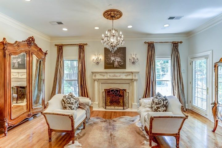 The gorgeous fireplace is in the sitting room of the master bedroom at 2860 Keasler Circle, Germantown, TN 38139.