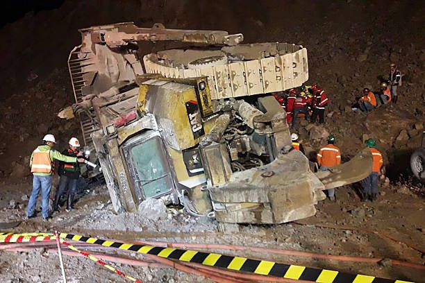 In this photo taken on October 17 a bulldozer is seen on its side after tumbling into an openpit mine in Grasberg one of the world's biggest gold and...