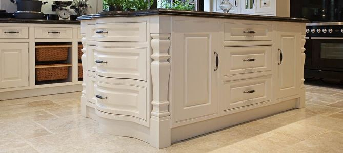 Cream bespoke kitchen in a traditional in-frame raised panel style.