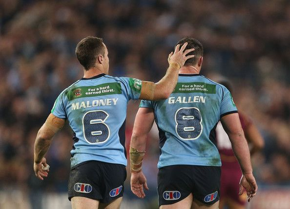 James Maloney and Paul Gallen of the Blues walk from the field at half time during game one of the ARL State of Origin series between the New South Wales Blues and the Queensland Maroons at ANZ Stadium on June 5, 2013 in Sydney, Australia.