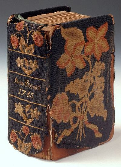 This is a Prayer book cover wrought by Ann Flower in 1765, the year of her marriage to Samuel Wheeler. This difficult piece was worked on canvas with fine crewel yarns, using Irish Stitches.