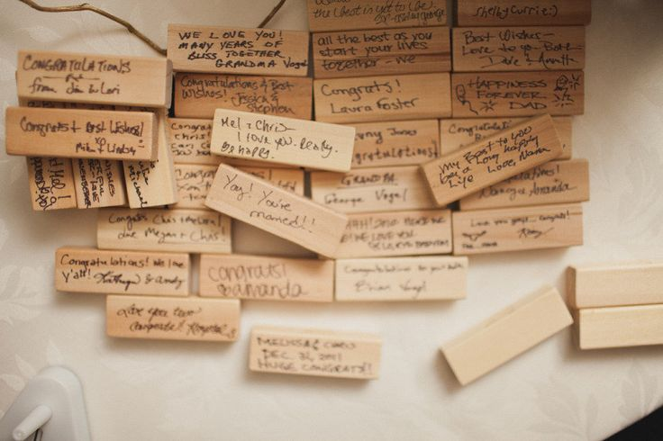 """Guest book alternative ~ This bride used pieces of a Jenga game, """"We opted to use Jenga games as our guest book so when we have game nights at home we can see the messages of love our friends and family left us on our wedding day. What a great way to remember it all!"""""""