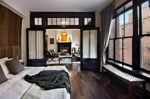 Wood floor, transom, window bench, windows, bed, behind the bed - the whole space. :)