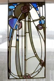Glass panel by Charles Rennie Mackintosh for The Rose Boudoir at the Turin International Exhibition of Modern Decorative Art, 1902. 69.6 x 34.5 cm | © The Hunterian Museum and Art Gallery, University of Glasgow
