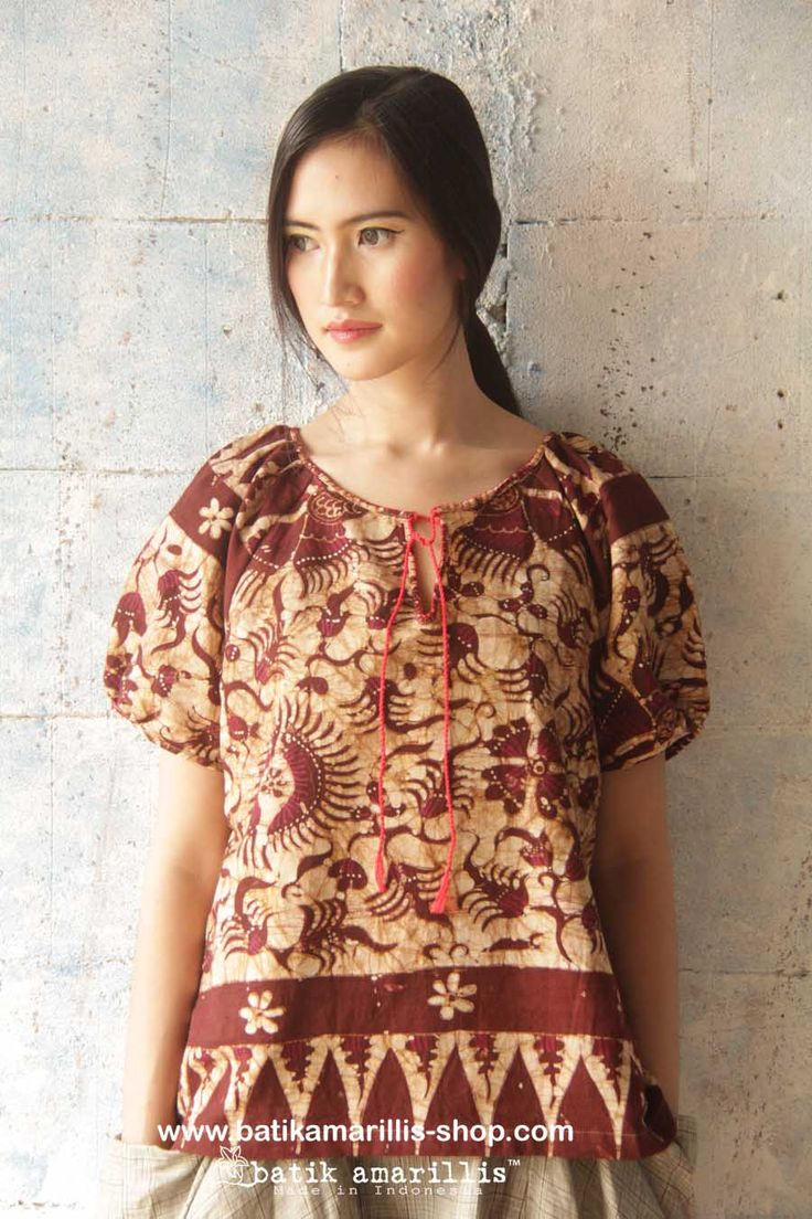 batik amarillis's innocencia blouse www.batikamarillis-shop.com .beautiful pleasant blouse made with batik gedog Tuban,Indonesia with lovely hand stiched and red cord .