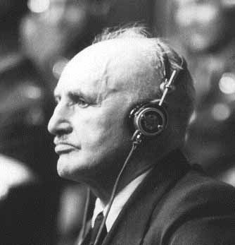 "Defendant Julius Streicher, Editor-in-Chief of the venomous anti-Semitic Nazi paper, Der Stürmer, takes the stand during the Nuremberg Trials. Streicher was sentenced to death by hanging. ""...He [Streicher] walked steadily the six feet to the first wooden step but his face was twitching.   ""As the guards stopped him at the bottom of the steps for identification formality he uttered his piercing scream, 'Heil Hitler!'     ""The shriek sent a shiver down my back..."""