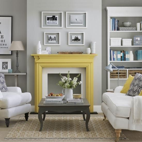 Grey Living Room With Feature Fire Place Using A Bright Colour Like Yellow Really Helps