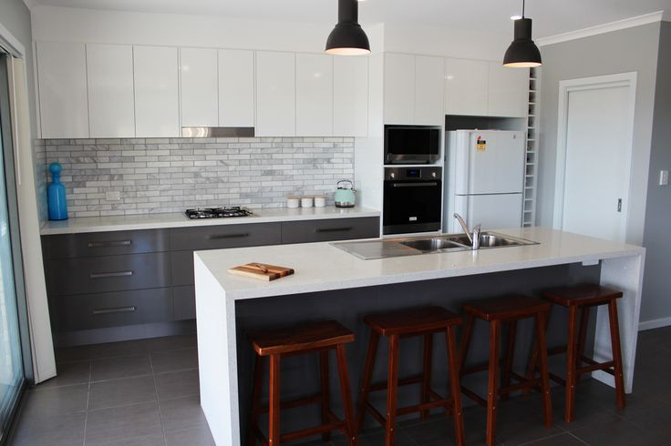 Trend White Star Stone Benchtops, White Silk overheads with moose silk base cupboards