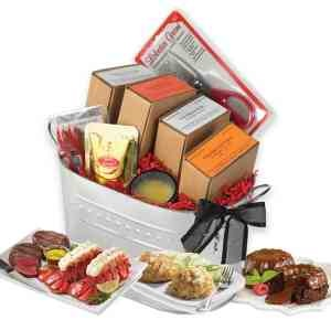 Sensational Seafood and Steak Gift Bucket. Package includes: two, 4-5 oz. Maine lobster tails, two 6 oz. filet mignon steaks, two 4 oz. Maryland style crab cakes, two 5 oz. Chocolate Lava cakes, Colombian Supremo coffee and clarified butter, two accessory kits and lobster shears, fully illustrated cooking manual and reusable galvanized silver bucket. Personalize with your logo and add a gift message for free!