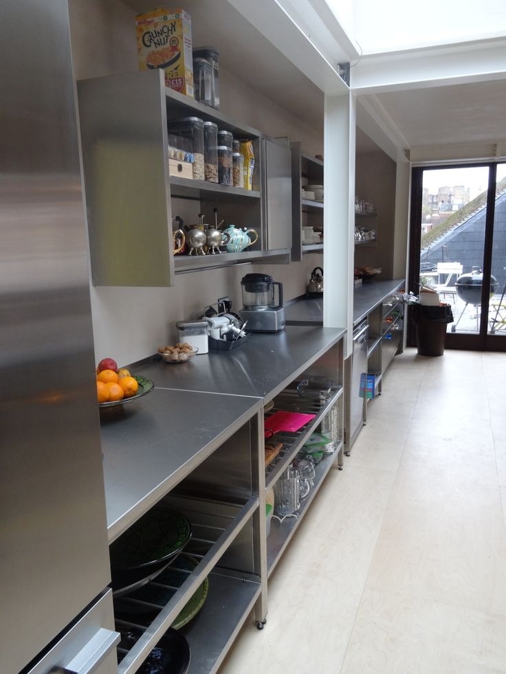 Wall units, worktops and base frames all in GEC Anderson brushed satin stainless steel