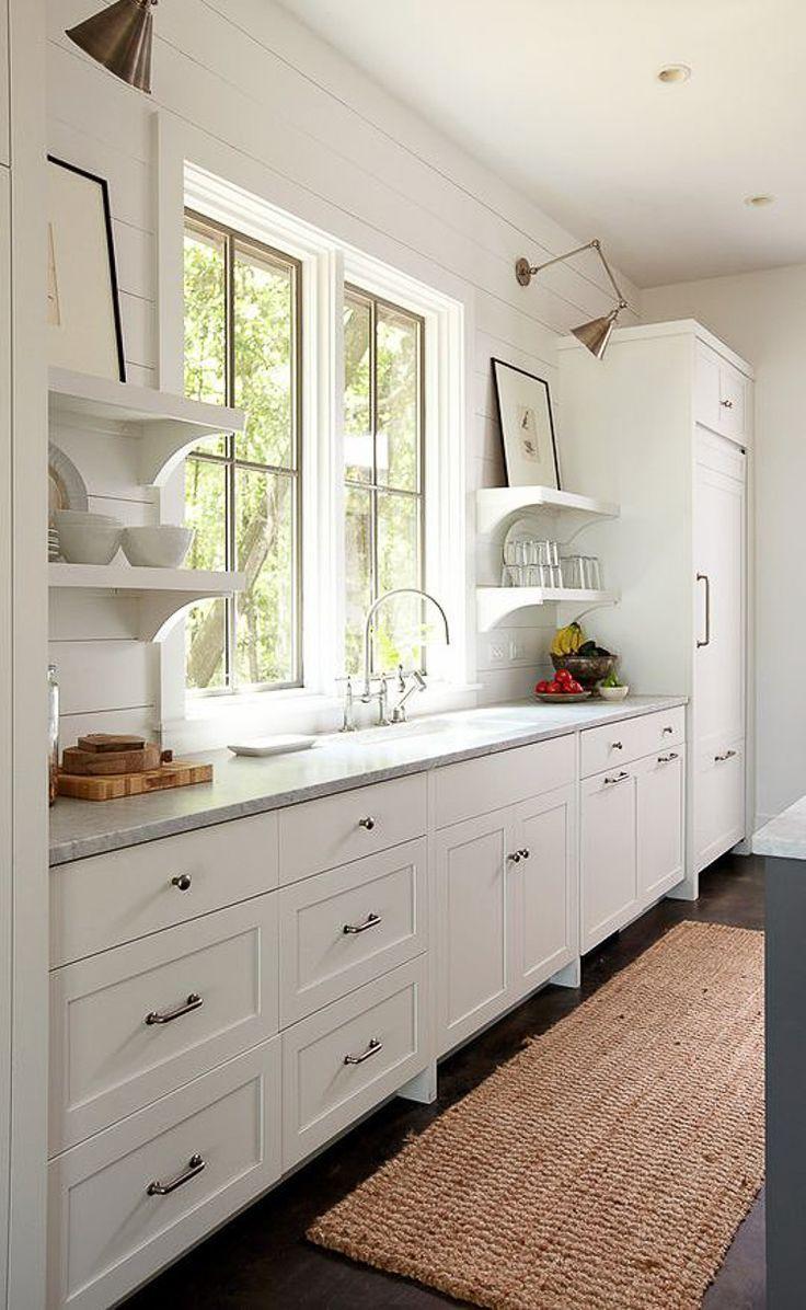 windows behind sink in farmhouse kitchen custom home builder in houston texas custom home build jouney