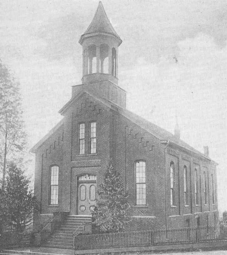 Presbyterian Church on Main Street hill, circa 1875. Pic taken from a postcard dated 1911. This later became the Star Theatre existing until the Wayne Theatre was built. Later still, the building served as a dance hall and a gymnasium before being remodeled for News-Virginian in 1940. Vacant today.