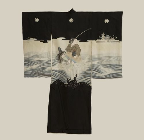 A fine plain silk ceremonial miyamairi kimono for a boy's initiation at a Shinto shrine, featuring yuzen-dyed motifs of Urashima Taro leaving the Ryugujyo underwater palace. Painting and couching embroidery highlights. Mid to late Meiji Period (1880-1911), Japan. The Kimono Gallery.