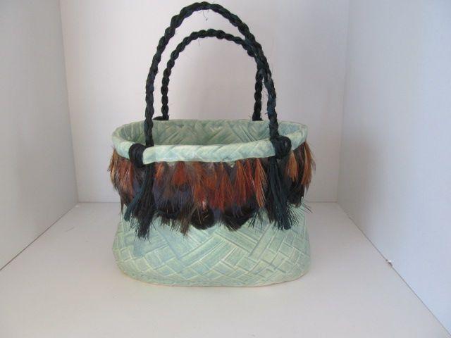 Ceramic Kete/basket form. Sea Urchin glaze - Paul Pepworth - Muka fiber handles, imprinted weaving pattern.
