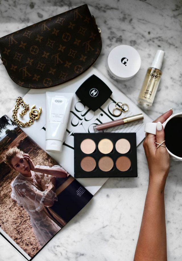 Go-to beauty essentials via For All Things Lovely   Louis Vuitton Cosmetic Case, Goop Luminous Melting Cleanser, Stila Liquid Lipstick in 'Caramello', Chanel Blush in 'Golden Sun', Chanel Bracelet, OUAI Finishing Crème, OUAI Hair Oil, La Mer Moisturizer, and Anastasia Beverly Hills Contour Kit