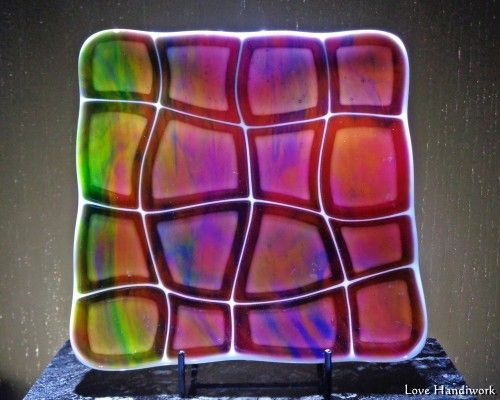 "This is popular plate made from a free pattern called ""Retro Warp"" provided by Spectrum Glass. It is wonky shaped pieces of a tie dye cranberry glass on white. It is beautiful with light shining throu"