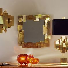 Puzzle Wall Mirror by Jonathan Adler | Inspired by a house of cards, the Puzzle Mirror is made of sheets of solid brass layered in a dynamic composition. Add intrigue to your foyer, bring moody glamour to your powder room, or bestow major majesty on your mantle. The structural geometry is tempered by the warm brass glow. ➤ Discover the season's newest designs and inspirations. Visit us at http://www.wallmirrors.eu #wallmirrors #wallmirrorideas #uniquemirrors @WallMirrorsBlog