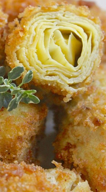 Ingredients one large jar of artichoke hearts in water (33 oz) flour for coating 1 egg 1 tbsp grated Parmigiano or Pecorino cheese salt and pepper breadcrumbs, for coating dried thyme dried parsley salt and pepper oil for deep frying