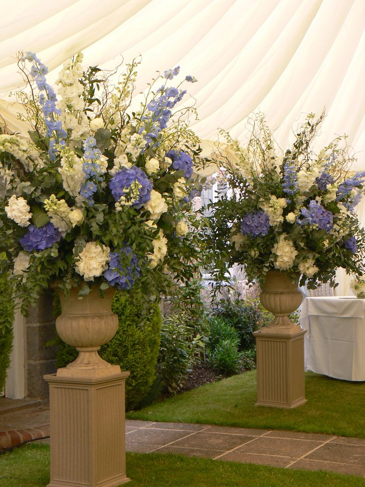 Ceremony Urn style, these can be white and green for church then have the blue flowers added later on.
