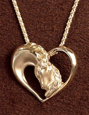 """http://www.equestrianjewelry.com    14k Gold Mare and Foal Pendant   A precious moment captured in gold. Diamond eyes. 1 3/8"""" wide x 1"""" high. Shown on a 14k gold wheat chain, item #K0027 shown below. A wonderful piece sure to make the horse lover happy! proudly made here in the USA!"""
