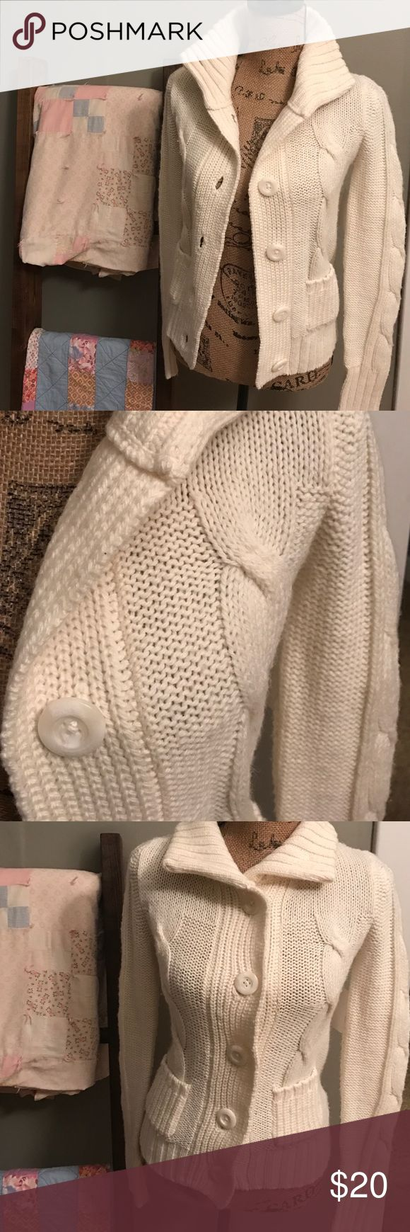 """Small American Eagle Cardigan Sweater Good Preloved condition. Some minor fuzzing on arms as shown. Cute chunky buttons and cable knit front. Winter white. Perfect versatile wardrobe addition! I have tons of listings and bundle discount. ✔️my closet to save 💰 on shipping! I ❤️Offers! Chest laid flat 32"""" armpit to bottom approx 14.5"""". American Eagle Outfitters Sweaters Cardigans"""