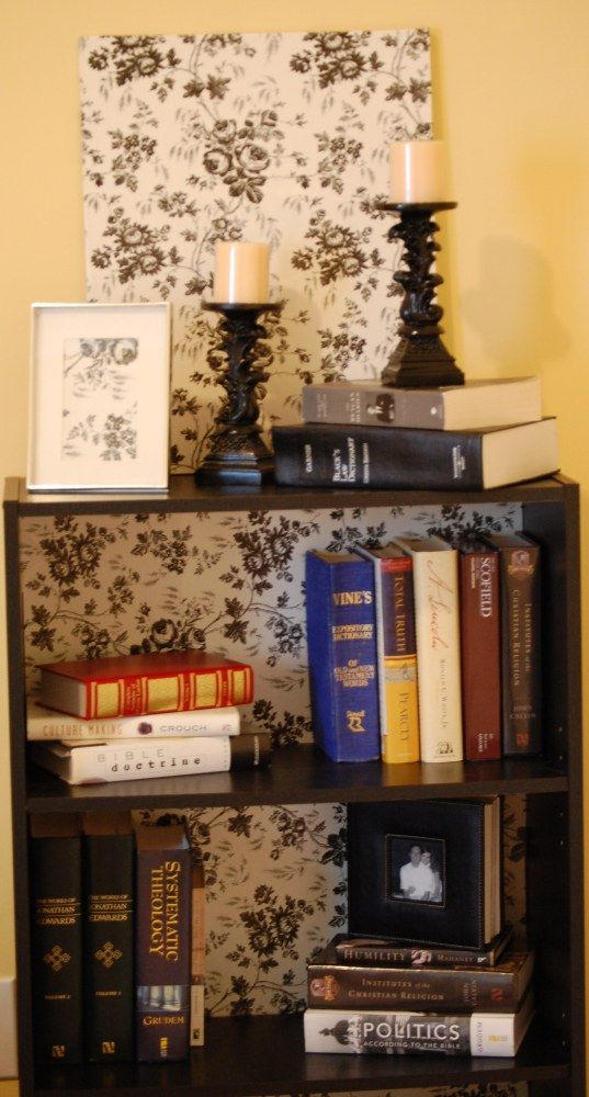Use a roll of kitchen cabinet liner from the Dollar Store to turn your old cheap bookshelves into trendy yet thrifty shelves. Perfect for dorm rooms!