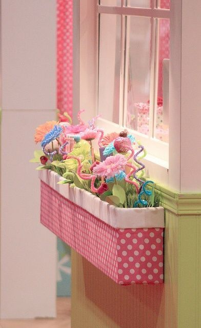 This indoor window box is so beautiful for the kids room. You can use large cardboard box that you cut in half, then glue fabric on the box with glue gun. Finally decorate with artificial flowers and ornaments as you desire. by seza.yardimci
