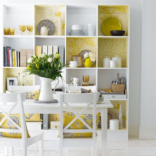 Cute wallpaper-backed bookcases --- have to try this! great way to bring in color/patterns