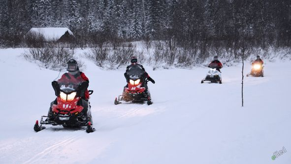 eSled with conventional snowmobiles.